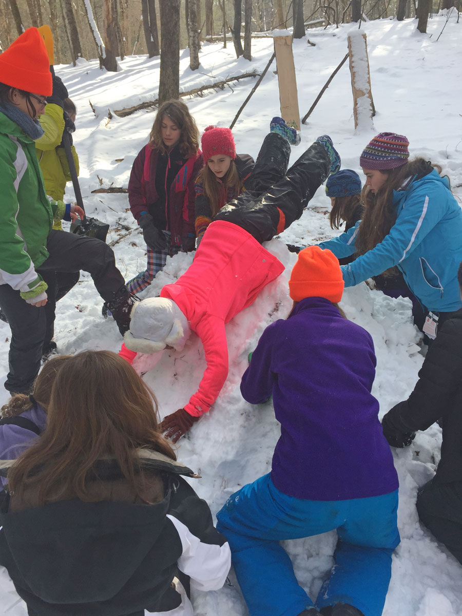 """Working"" hard on building a snow fort!"